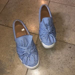 Blue and white striped sneakers